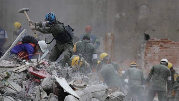 Rescue workers search for survivors at an apartment building that collapsed during an earthquake in the Condesa neighbourhood of Mexico City, Thursday.