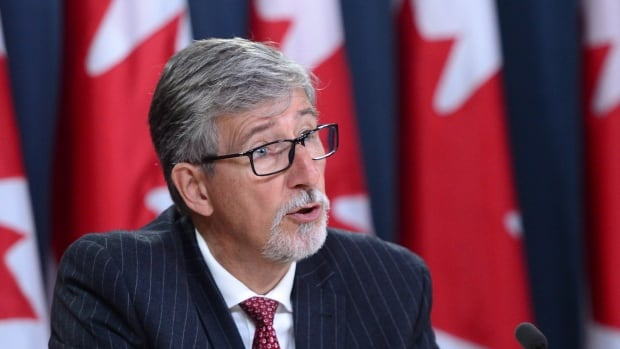 Privacy commissioner Daniel Therrien holds a news conference in Ottawa on Thursday to discuss his annual report. His office intends to launch its own investigations rather than merely reacting to complaints.