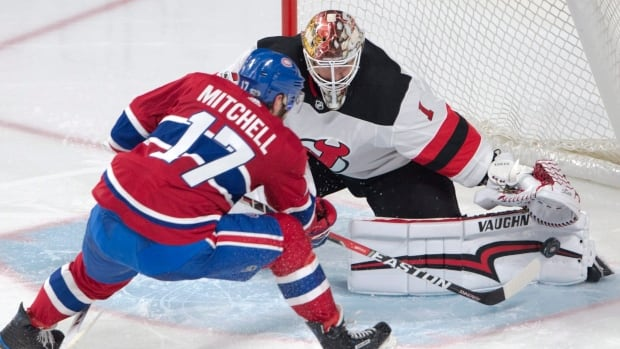 Montreal Canadiens centre Torrey Mitchell is stopped by New Jersey Devils goalie Keith Kinkaid during the second period Thursday.