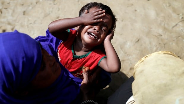 Fear and terror are a constant for many of the children who make up about 60 per cent of the more than 420,000 Rohingya Muslims who have fled terrible persecution in Myanmar. This child is in line for aid in a camp in Cox's Bazar, Bangladesh, on Friday.