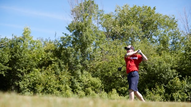 Ret. Cpl. William Werth hits the links on Tuesday at the Invictus Games.
