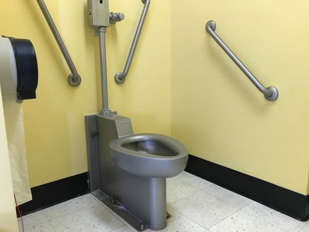 stainless steel toilet replaces porcelain, to accommodate larger patients.