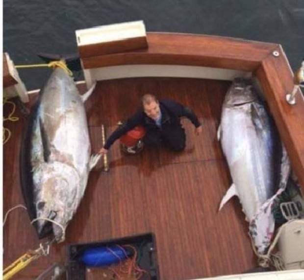 Greer Hunt catches two tuna