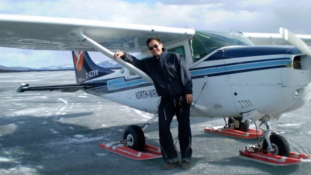 Benjamin is a Gwich'in fiddler and also a pilot. He poses with a North-Wright Airways plane in Norman Wells, NT where he worked from 2007 to 2008.