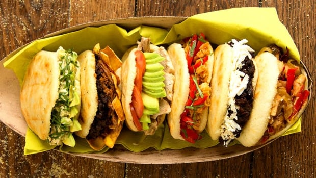 The corn flour arepa, similar to the El Salvadorean pupusa, is a round dough patty, grilled, then sliced open and packed with a variety of fillings.