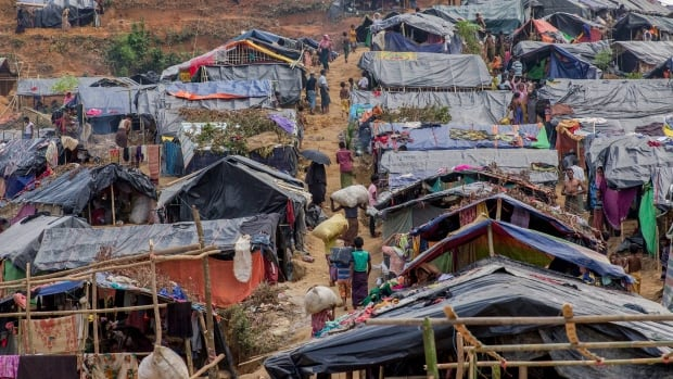 Newly set up tents cover a hillock in Taiy Khali, Bangladesh Friday at a refugee camp for Rohingya Muslims from Myanmar. More than 420,000 Rohingya have fled to Bangladesh in less than a month.