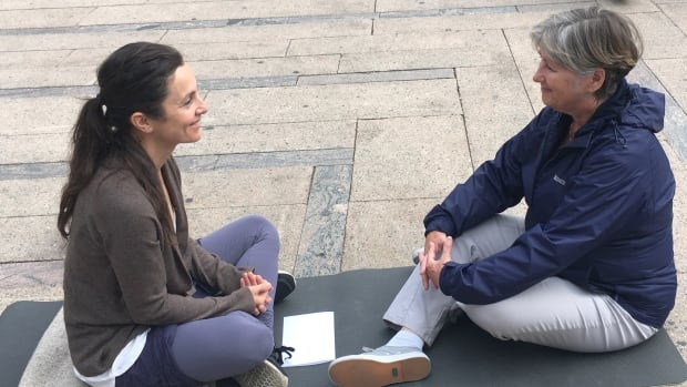 Some brave Vancouverites will gather Saturday at Robson Square to sit silently and stare deeply into a stranger's eyes as part of an international experiment in human connection. Morgaine Owens, left, sits across from a stranger in Vancouver.
