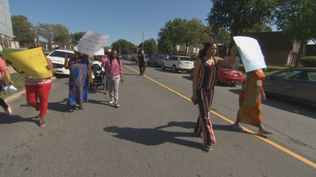 About a dozen mothers marched to demand better security at an Ottawa Community Housing complex Caldwell Avenue on Friday, Sept. 22, 2017.