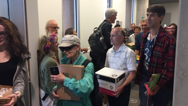 Members of the group Save Hawthorne Park present signed forms to the city clerk's office at Surrey City Hall.