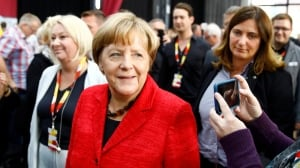 Merkel pitches German voters steady course while far right makes waves
