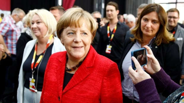 German Chancellor Angela Merkel arrives for an election rally in Wismar on Tuesday.
