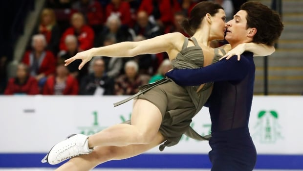 Canada's Tessa Virtue and Scott Moir, shown in this file photo, sit first after the ice dance short program at the Autumn Classic International in Montreal on Friday.