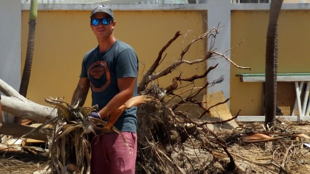 Brett Gloor, a teacher at the Caribbran International Academy helps to clean up the compound on the Ontario accredited school in St. Maarten after Hurricane Maria.