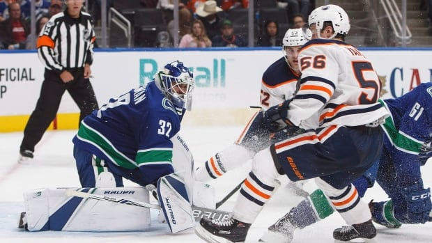 Canucks goalie Richard Bachman makes a save on Kailer Yamamoto (56) of the Oilers during pre-season play on Friday, in Edmonton, Alta.