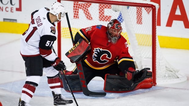 Calgary Flames goalie Mike Smith, right, finished with 15 saves in the team's 4-2 victory over the Arizona Coyotes on Friday.