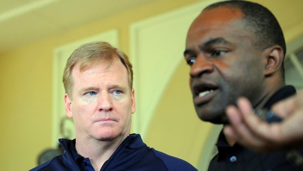 NFL commissioner Roger Goodell, left, and National Football League Players Association executive director DeMaurice Smith, seen in this file photo, responded on Saturday to demands from U.S. president Donald Trump that owners fire players who kneel during the national anthem.