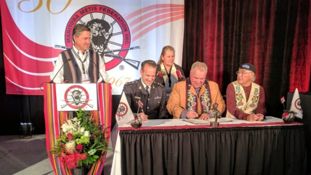 RCMP Deputy Commissioner Kevin Brosseau and MMF president David Chartrand signed a memorandum of understanding for the return of artifacts connected to Louis Riel on Saturday in Winnipeg.