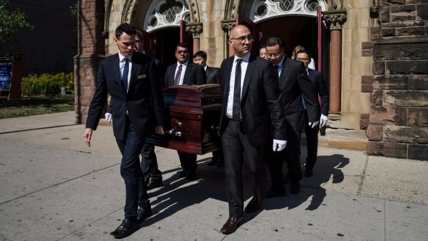Many of Arnold Chan's colleagues were honorary pallbearers, including Conservative MP Erin O'Toole and Immigration Minister Ahmed Hussen.