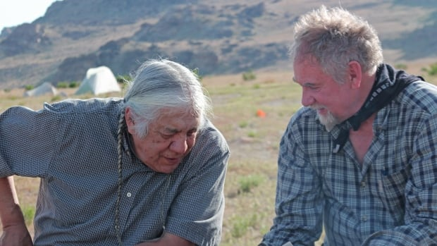 Elder Bruce Starlight, a member of the Tsuut'ina Nation and co-organizer of the Dene Migration Symposium, with University of Alberta professor John Ives in Utah on an archeology project.