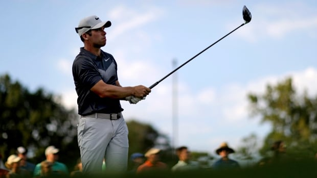 Paul Casey of England tees off the 18th hole during the third round of the Tour Championship.