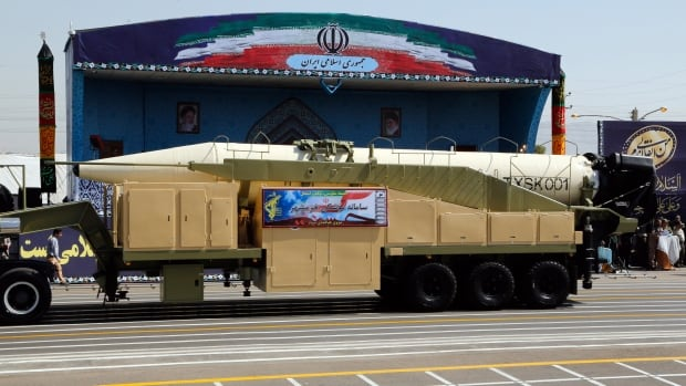 The new long-range missile Khoramshahr is displayed during the annual military parade in Tehran on Friday when President Hassan Rouhani said Iran would strengthen its missile capabilities.