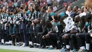 NFL protests: Players link arms, kneel during national anthem