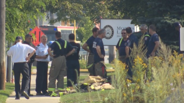 Toronto Fire Service crews gather outside a company in Etobicoke where an ammonia leak occurred on Sunday.
