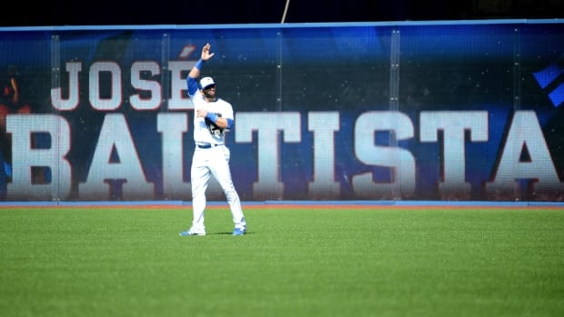 Jose Bautista acknowledges the crowd after taking his position in right field in what may have been his final home game with the Toronto Blue Jays.
