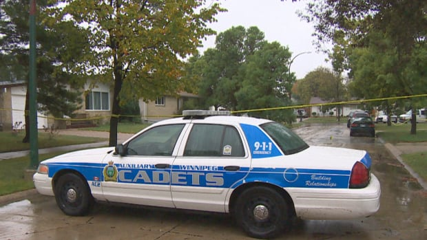 Cadets and members of Manitoba's Independent Investigation United had a section of Madrigal Close cordoned off Sunday. An officer was stabbed and a man was fatally shot by police in a home on the street, police said.