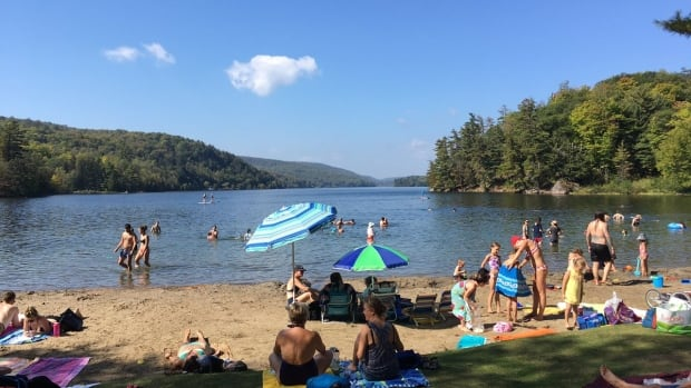 People beat the heat by the water at Meech Lake on Sept. 24, 2017. Heidi Staples submitted this photo to CBC Ottawa climatologist Ian Black as the city broke a weather record for the day with a high of 31 C.