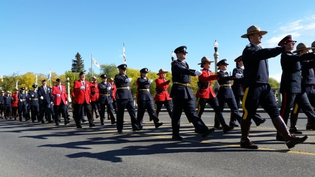 Crowds watched as police and peace officers marched onto the legislature grounds to begin Sunday's ceremony.