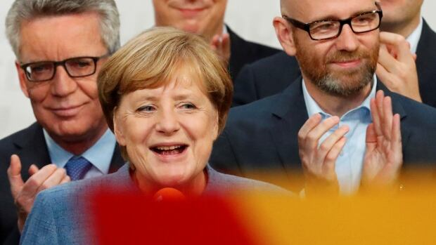 German Chancellor Angela Merkel reacts after winning the German general election in Berlin. Merkel's conservative bloc emerged as the largest parliamentary party but saw its support slump to the lowest since 1949.