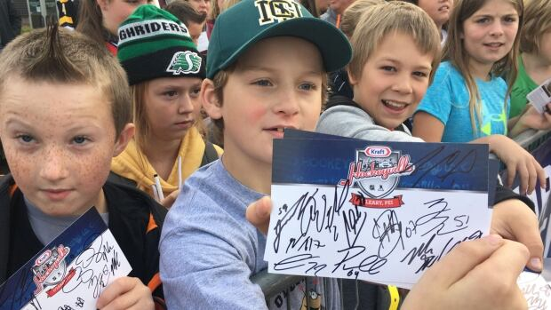 Students from Bloomfield Elementary show off their Hockeyville autographs.