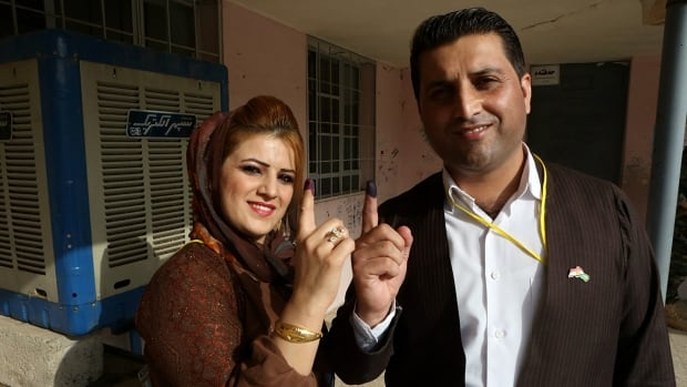 Iraqi Kurdish voters show their inked fingers after casting ballots during the referendum on independence from Iraq in Irbil on Monday. Iraq's Kurdish region is voting in a referendum on whether to secede from Iraq.
