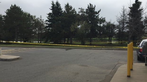 An area along the Neebing-McIntyre Floodway in Thunder Bay, Ont., is cordoned off by police tape. The body of a deceased male was found in the floodway on Sunday.