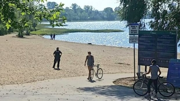 Ottawa police evacuated Westboro Beach on a hot Sunday afternoon after someone reported seeing a male with what looked like a gun.
