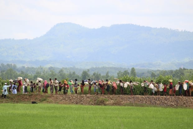 Line of Rohingya refugees
