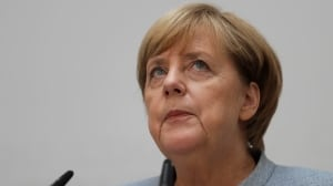 'We were all really shocked:' Angela Merkel supporters have awoken to big gains by far right