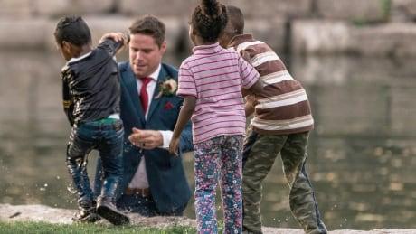 Groom Clay Cook saves boy kitchener victoria park water pond river