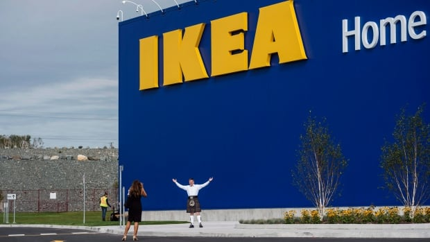 A man in a kilt poses in front of the new Ikea store in Dartmouth on Monday.