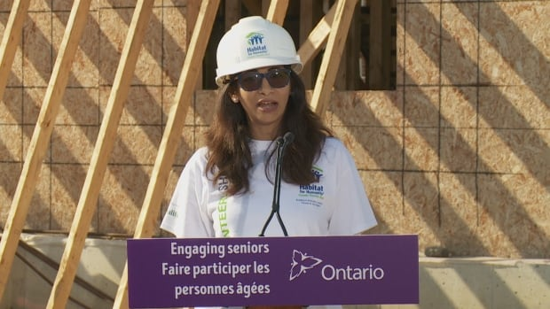 Ontario's Seniors Affairs Minister Dipika Damerla, wearing a hard hat at Habitat for Humanity's site on Pinery Trail in Scarborough, says the provincial government is expanding its Seniors Community Grant Program.