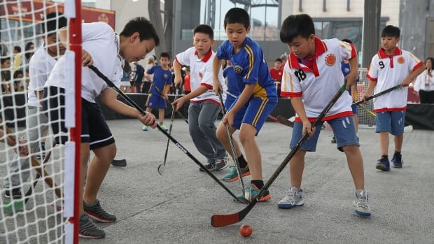 Children take part in the NHL Fan Fest in Beijing on Sept. 23 prior to a pre-season game there between the Los Angeles Kings and the Vancouver Canucks.
