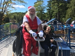 Acey Rowe and Santa Claus ride a roller coaster