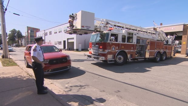 Firefighters demonstrate how the truck isn't able to turn when vehicles are parked in front of the station. The area is a no-parking zone where drivers could be ticketed and towed.