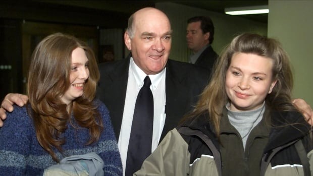 Clayton Johnson, flanked by his daughters Dawn, left, and Darla, stands outside Nova Scotia  Appeal Court  in Halifax on Monday, Feb.18, 2002. The court overturned Johnson's 1993 murder conviction in the death of his wife and ordered a new trial.
