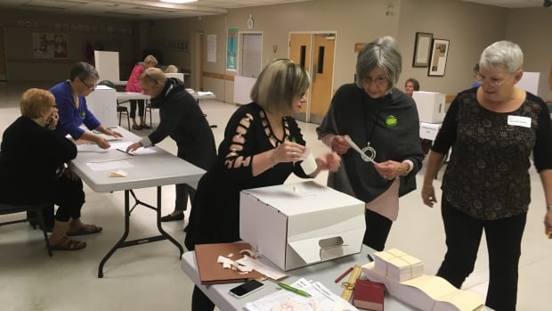 Polling staff preparing for the start of municipal election voting in Corner Brook Tuesday morning.