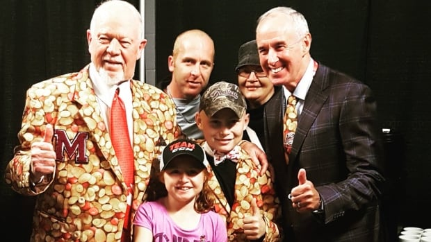 Don Cherry and Ron MacLean pose in their potato attire.