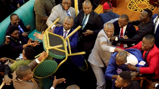 Ugandan lawmakers involved in a fight in parliament ahead of proposed age limit amendment bill debate in Kampala, Uganda, on Sept. 26, 2017.