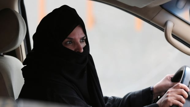 A woman drives a car on a highway in Riyadh in March 2014 as part of a campaign to defy Saudi Arabia's ban on women driving.