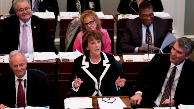 Nova Scotia Finance Minister Karen Casey delivers the provincial budget Tuesday as she stands next to Premier Stephen McNeil (right) at the Nova Scotia Legislature.